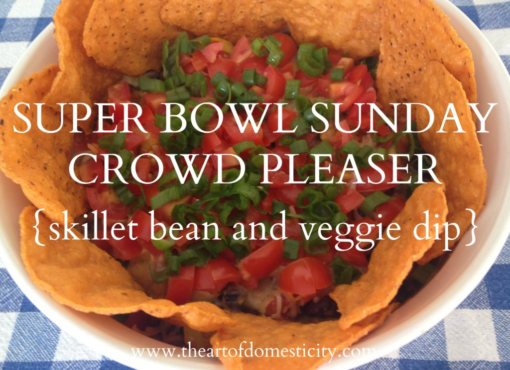 Are you looking for a simple and delicious dip for the Super Bowl?? This Skillet Bean and Veggie Dip is sure to be a hit!!